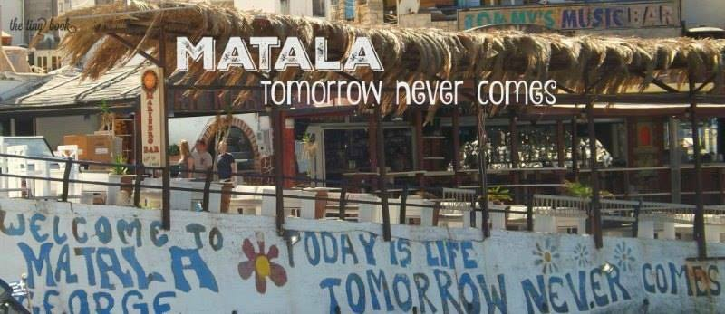 A view of the beach of Matala, Crete, with the wall grafiti: Today is Life, Tomorrow Never Comes