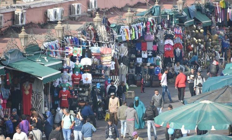 Chaos and confusion in Place Jemaa el Fna. Avoid scams in Marrakech