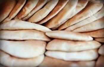 Pita bread. Greek bread. Greek Tastes: Different types of bread from Greece.
