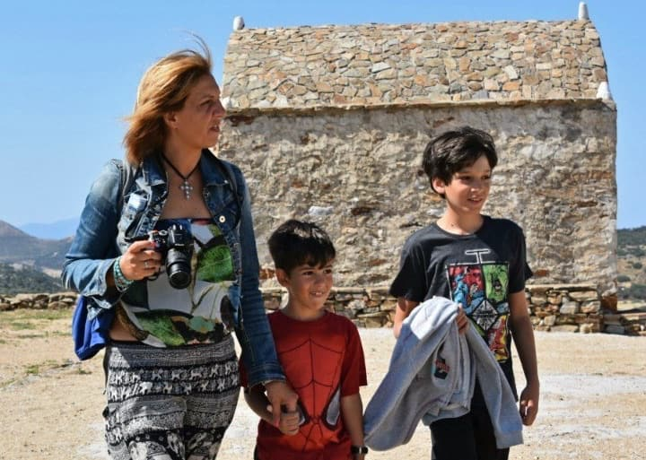 Kids and mom traveling in Greece.