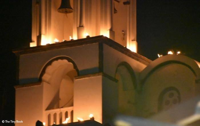 Church with glowing cans on the bell tower.