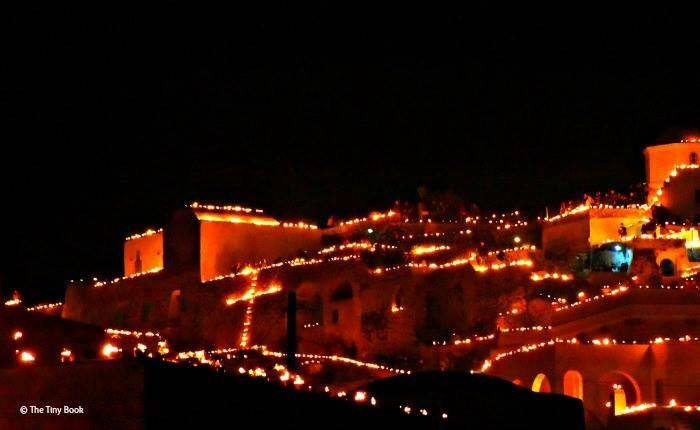 The village glowing in the dark.Pyrgos (Santorini) during Good Friday.