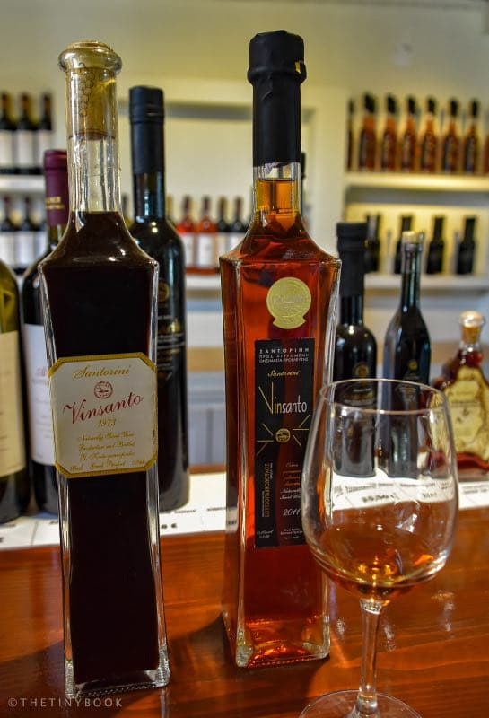 two bottles of Vinsanto Wine from Santorini and a glass