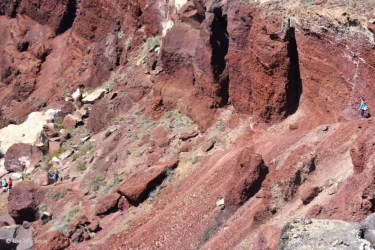 Hiking to reach the Red Beach in Santorini.