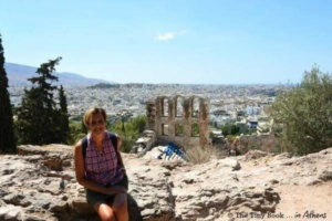 A wonderful day in Athens. The Odeon, the city of Athens and the sea behind. Athens Mythological Tour.