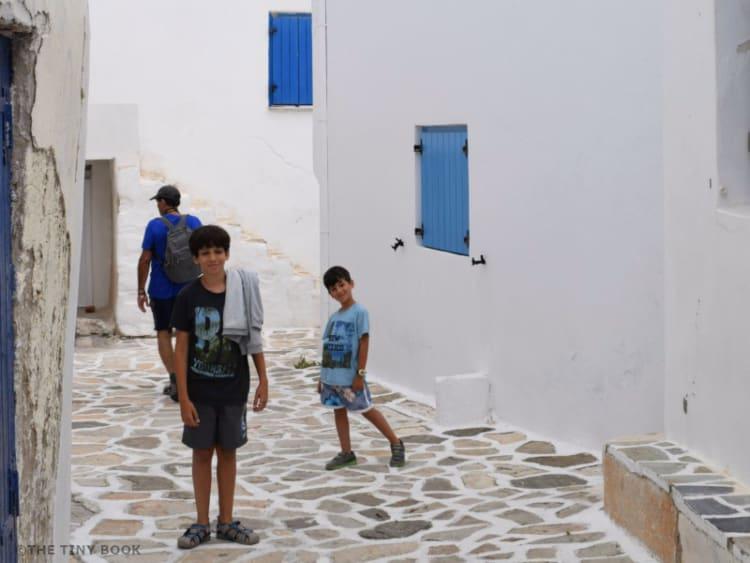 Kids walking in the kastro of Antiparos island, Greece