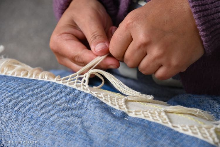 cloth of naxos and artisan hands working