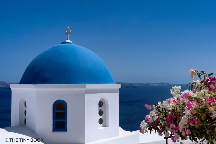 Blue-domed church, iconic sight of Santorini island.