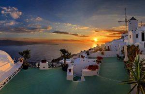 GREECE - SANTORINI - WINDMILL - SUNSET AT THE CALDERA