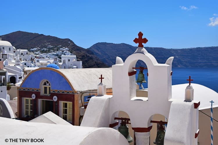 Oia, church and domes by the sea, Santorini Itinerary