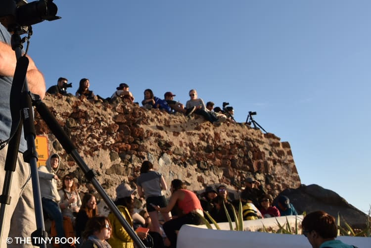 Photo hour, everyone finds a place on the ruins of the castle and waits patiently for the sunset over Santorini's caldera.