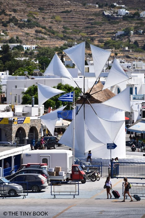 A traditional Cycladic windmill welcomes visitors in the port of Paros.
