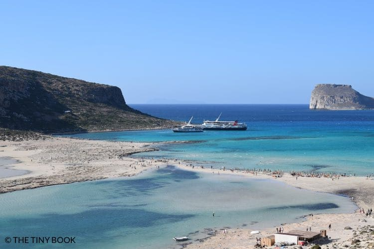 Boats and beach bar in Balos, Crete.