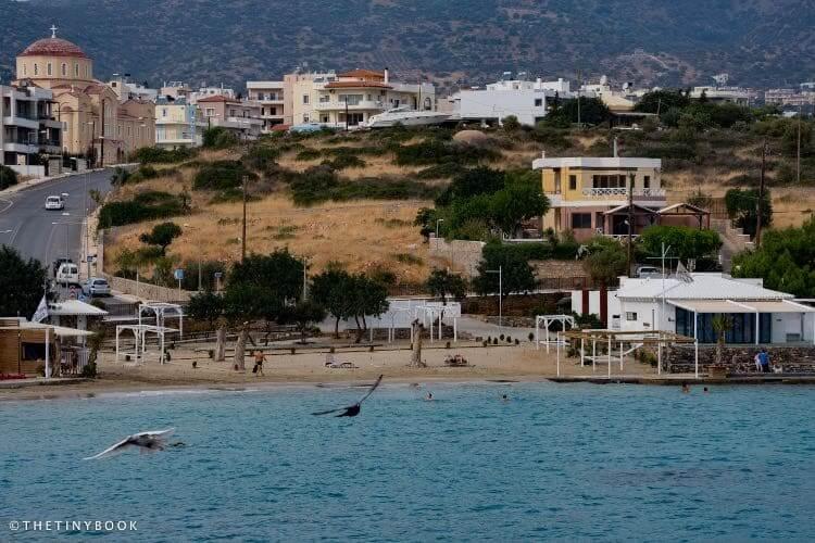 Amoudi beach. Behind, the church of Agios Antonios.