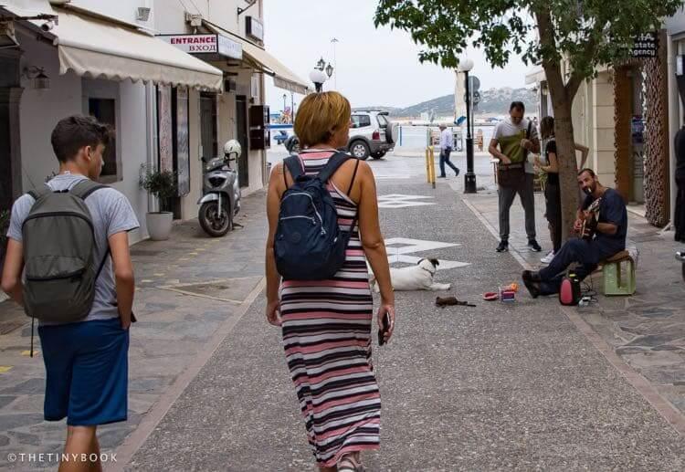 Mom and son walking on pedestrian street Crete