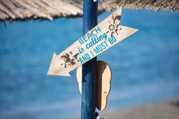 Signpost at the beach - Beach is calling and i must go in Nea Chora, Crete