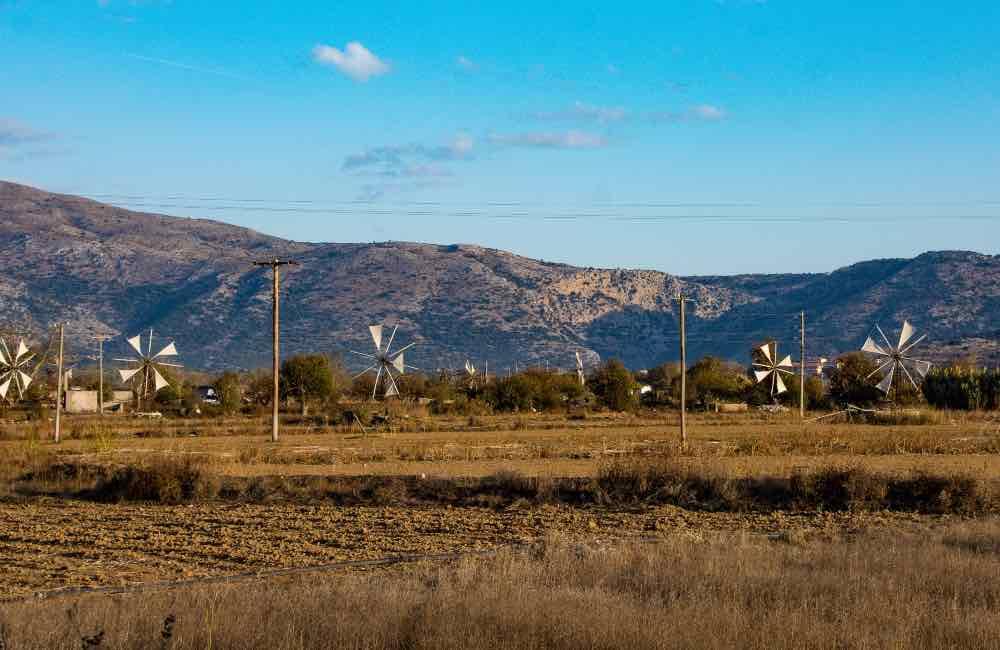 Windmills with white sails open, Lasithi, Crete