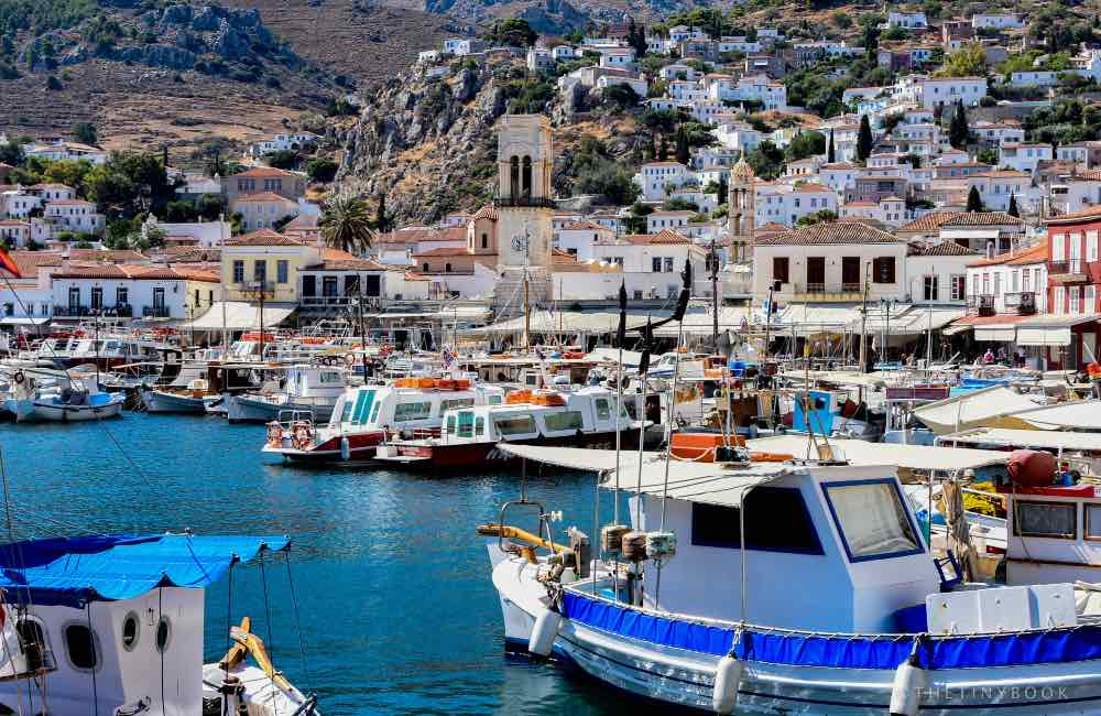 Greek landscape, houses on a hill, boats - Hyra island port