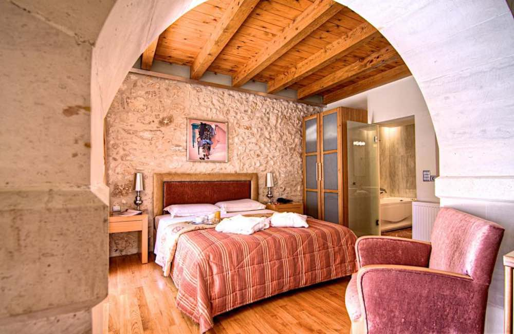 hotel room, bed, chair, arches, Rethymnon, Crete