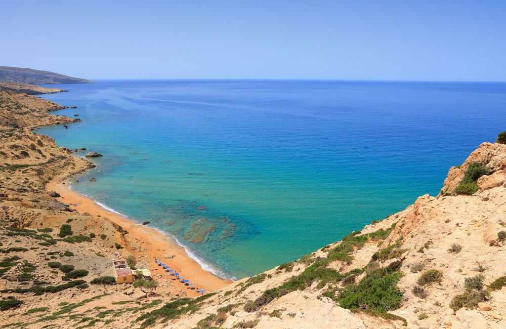 GREECE-CRETE-MATALA-RED-BEACH-FROM-ABOVE